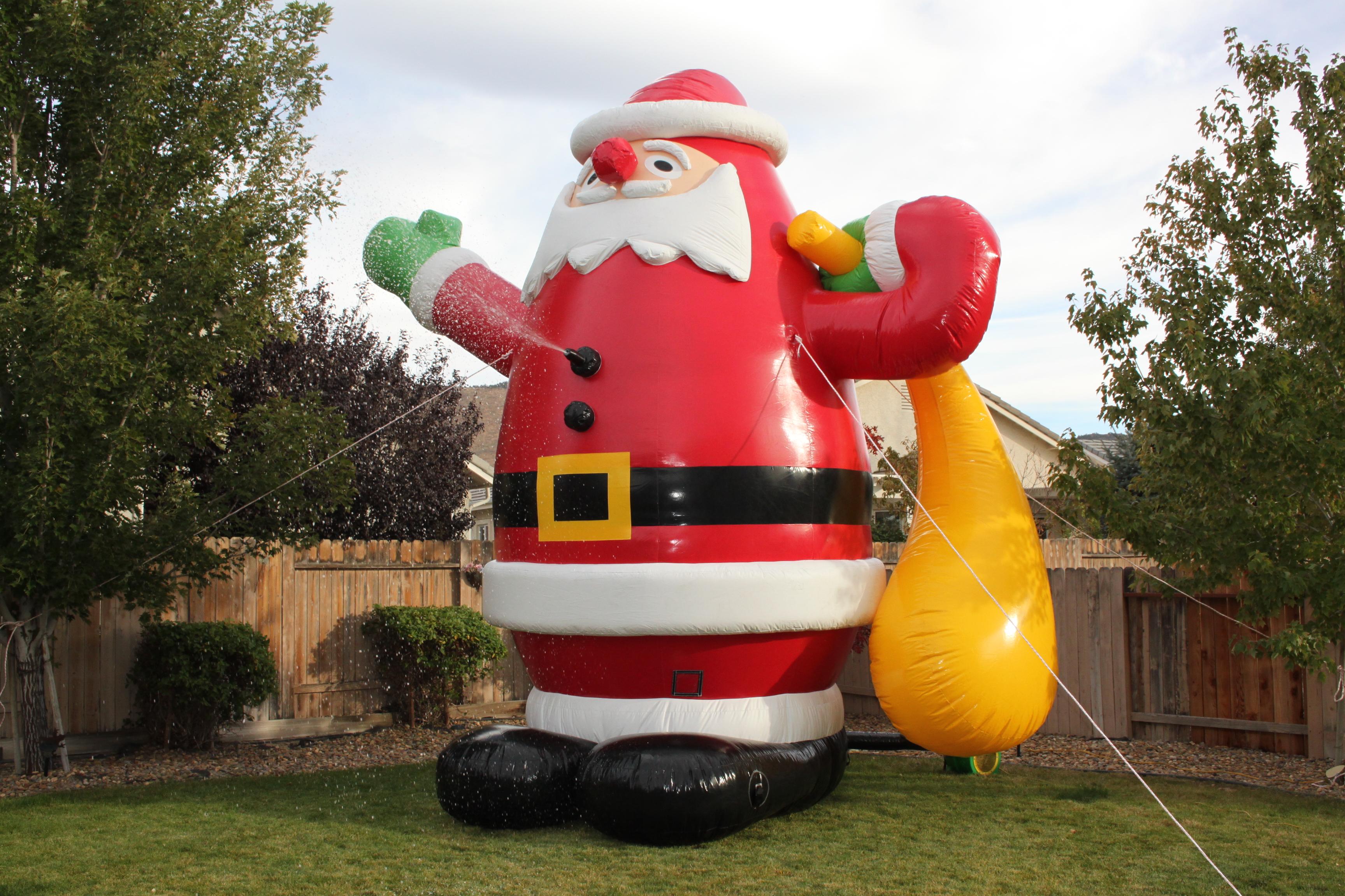 Snow machine rental inflatable santa claus lets party